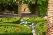 Courtyards and gardens of the famous Palace of the Alcazaba in M — Stock Photo