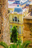 Elegant yellow houses with green windows in the city of Malaga,  — Stock Photo