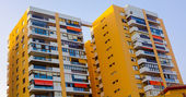Modern buildings with balconies and terraces in yellow — Stock Photo
