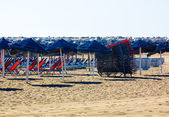 Sun loungers and parasols ready to install on the beach — Foto de Stock