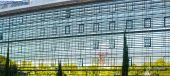 Reflections in a modern glass facade — ストック写真
