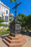 Wrought iron cross highly decorated in a park in Seville, Spain — Stock Photo