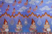 Thai buddhist paintings of dieties on the temple walls — Stock Photo