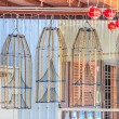 Fish traps hanging  outisde a house — Stock Photo #72981079