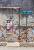Penang wall artwork named Children on the Swing — Stock Photo