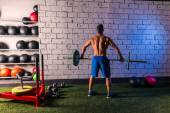 Barbell weight lifting man rear view workout gym — Stock Photo