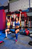 Gym women barbell plates rising workout — Zdjęcie stockowe