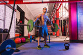 Barbell weight lifting man workout exercise gym — Stock Photo