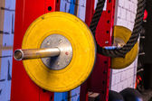 Barbells in a gym bar bells and rope — Stock Photo