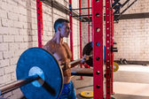 Barbell weight lifting man weightlifting at gym — Stock Photo