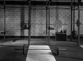 Gym nobody with barbells kettlebells and bars — Stock Photo