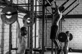 Barbell weight lifting group weightlifting at gym — Foto Stock