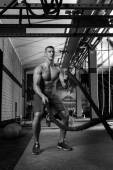 Battling ropes man at gym workout exercise — Stock Photo