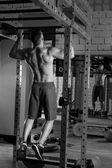 Toes to bar man pull-ups 2 bars workout — Stock Photo