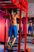 Toes to bar man pull-ups 2 bars workout — Stock Photo