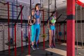 Gym girls muscle ups rings gym workout — Stock Photo