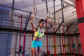 Dip ring girl woman workout at gym — Stock Photo