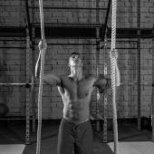 Climb with two 2 ropes exercise man at gym — Stock Photo