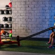 Sled rope pull woman pulling weights workout — Stock Photo #56095831