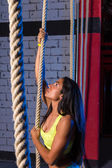 Climb rope exercise woman at gym — Stock Photo