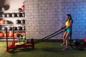 Sled rope pull woman pulling weights workout — Foto Stock