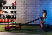 Sled rope pull woman pulling weights workout — Stock Photo