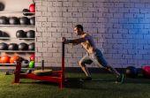 Sled push man pushing weights workout — Stock Photo