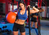 Gym woman with weighted ball and rope — Stock Photo