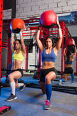 Gym women weighted ball workout exercise — Stock Photo