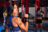 Gym women with hex barbell workout — Stock Photo