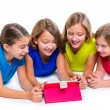 Sisters kid girls with tech tablet pc playing happy — Stock Photo #57785157