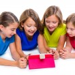 Sisters kid girls with tech tablet pc playing happy — Stock Photo #57785167