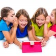 Sisters kid girls with tech tablet pc playing happy — Stock Photo #57785207