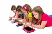 Sisters kid girls tech tablets and smatphones — Stock Photo