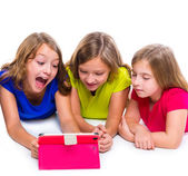 Sisters kid girls with tech tablet pc playing happy — Stockfoto
