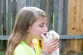 Blond kid girl with puppy pet chihuahua playing — Stock Photo