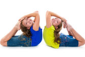 Twin kid sisters symmetrical flexible playing happy — Stock Photo