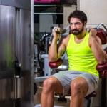 Abdominal crunch machine workout man — Stock Photo #59383495