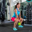 Goblet kettlebell squat woman workout at gym — Stock Photo #59389467