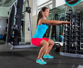 Air squat woman exercise at gym — Stock Photo
