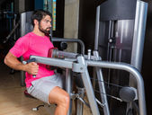 Seated back row machine man workout at gym — Stock Photo
