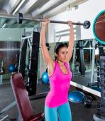 Brunette narrow grip barbell shoulder press — Stock Photo