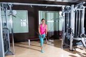 Standing Cable Crossover Fly flies woman workout — Stock Photo