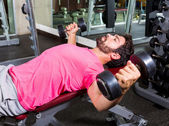 Dumbbell Incline Bench Flyes opening arms man — Stock Photo