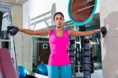 Dumbbell lateral shoulder flies fly girl workout — Stock Photo