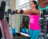 Dumbbell front shoulder flies fly woman workout — Stock Photo