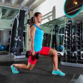 Dumbbell lunge woman exercise at gym — Stock Photo