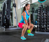 Goblet kettlebell squat woman workout at gym — Stock Photo