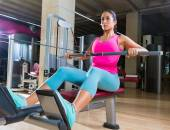 Low pulley rows woman wide grip seated girl — Stockfoto