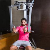 Pec-deck flye pec deck chest workout man — Stock Photo